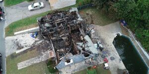 WASHINGTON (Sept. 24, 2019) ¬— Ariel view of a burned-out home impacted by the Sept. 13, 2018 natural gas explosion and fire in Merrimack Valley, Massachusetts. The photo taken on Sept. 13, 2018 was captured by a drone operated by an NTSB investigator to document the damaged caused by the explosions and fires. (NTSB photo).